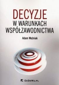 Decyzje o warunkach współzawodnictwa - okładka książki